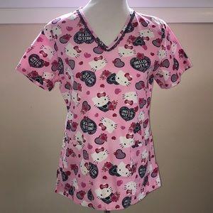 Tops - Hello Kitty scrub top .  Size XS.